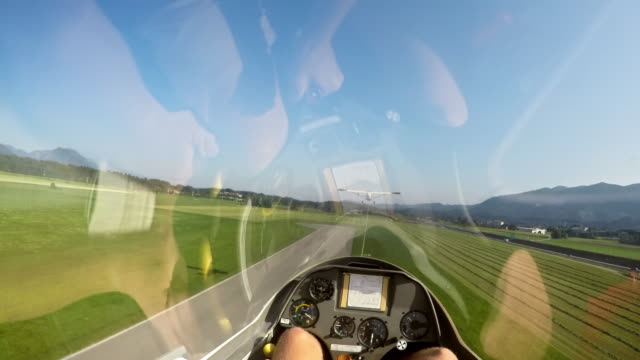 POV Pilot taking off in a sailplane on a sunny day