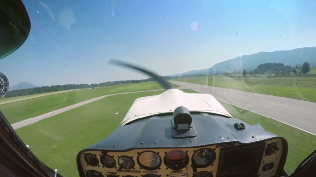 POV Pilot taking off in the light aircraft in sunshine Point of view shot of a pilot taking off in his light plane on a nice sunny day. Shot in Slovenia. propeller stock videos & royalty-free footage
