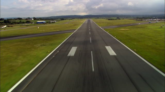 Pilots Eye View Of Take Off  - Aerial View - England, Devon, East Devon District, United Kingdom Take off down Exter Airport runway - POV from front of plane airport runway stock videos & royalty-free footage
