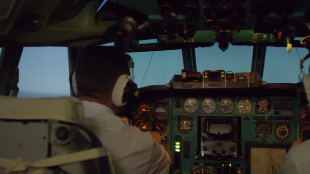 Bидео Pilots Operating Flight Instruments while Flying Airplane