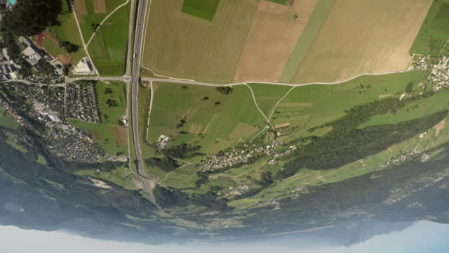 POV Pilot's view from the plane he is turning upside down above the countryside