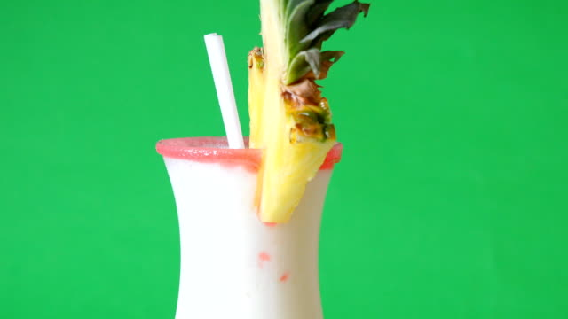 Pina Colada Over Green Background