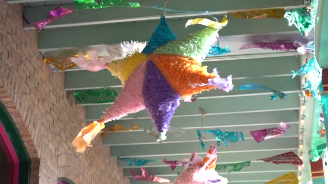 piñata hanging in outside patio and moving with the wind - san antonio texas stock videos & royalty-free footage