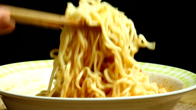 pinching  instant noodles in bowl - pasta video stock e b–roll