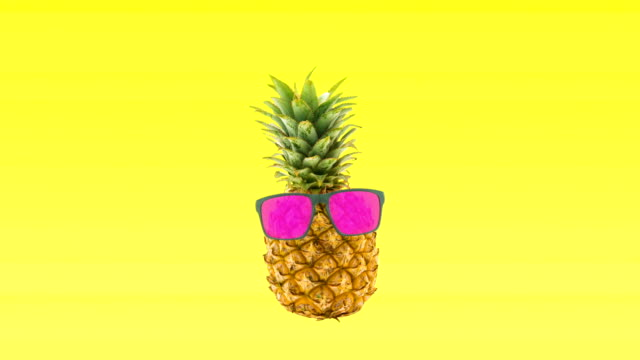 Pineapple dancing with pink glasses yellow background for beach party video