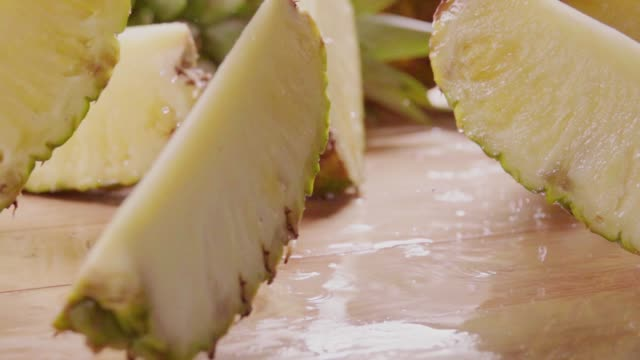 Pineapple divide into slices . Slow motion