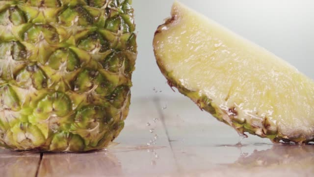 pineapple slice separate . slow motion - succoso video stock e b–roll