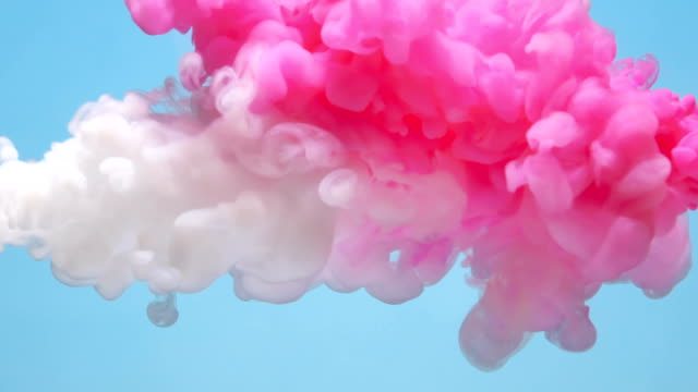 SLOW-MO: Pink and white liquid flow video