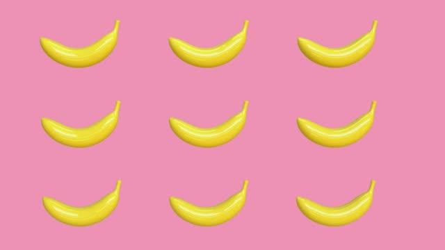 ピンクの背景黄色の抽象的なバナナ漫画のスタイルの3d レンダリング食品/果物健康なコンセプト - バナナ点の映像素材/bロール