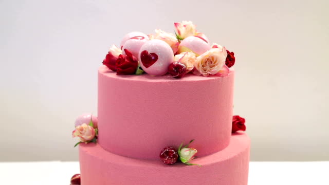 Pink cake for lovers. Cake is decorated with a heart on Valentine day