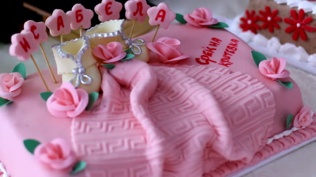 Pink cake with shoes and flowers for christening video