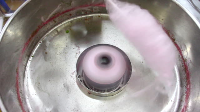 Pink Cotton Candy Preparing process of a cotton candy. cotton candy stock videos & royalty-free footage