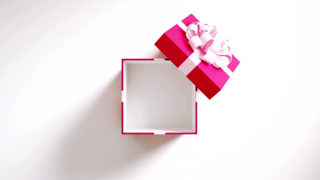 vídeos de stock e filmes b-roll de pink gift box opening on white background in 4 k resolution - gift box
