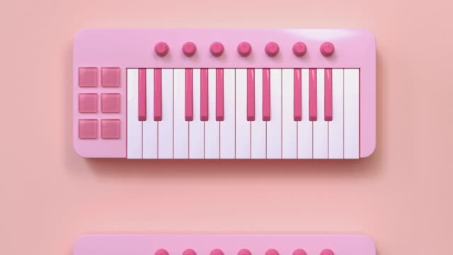 pink mini keyboard piano cartoon style abstract motion 3d rendering video