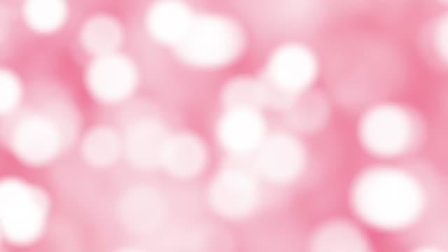 vídeos de stock e filmes b-roll de pink particles that move around - glow