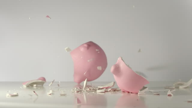 SLOW: Pink pig money box falls on a table and breaks on a pieces SLOW: Pink pig money box falls on a table and breaks on a pieces piggy bank stock videos & royalty-free footage