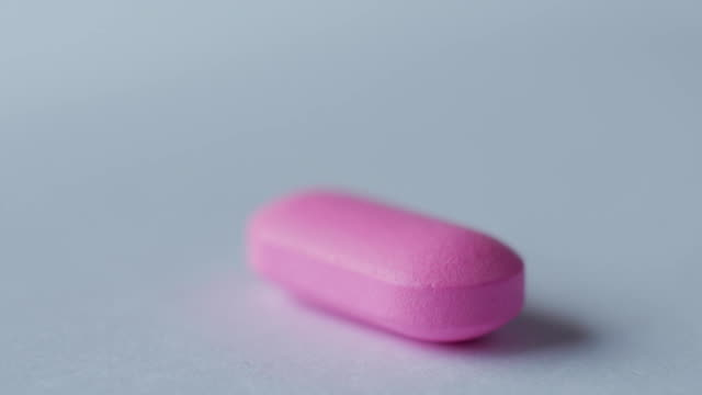 vidéos et rushes de pilule rose sur un ordinateur de bureau - un seul objet