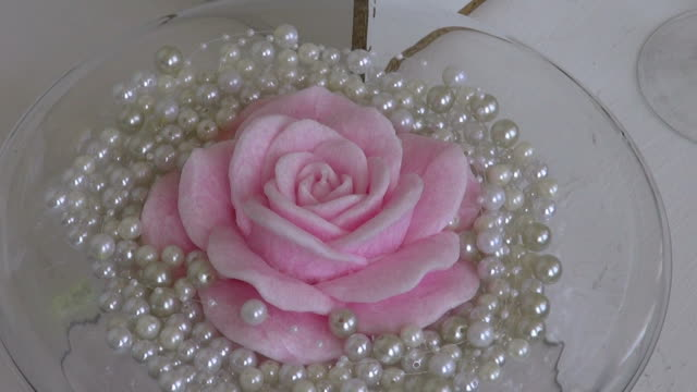 Pink rose shaped wax candle decorations video