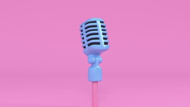 vídeos de stock e filmes b-roll de pink scene cartoon style microphone and music note levitation 3d rendering music entertainment concept - eternidade