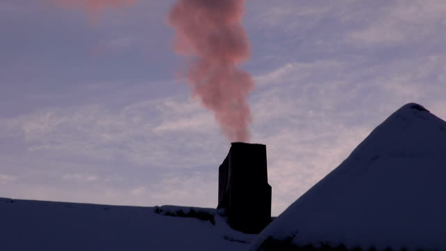 Pink smoke coming from house chimney video