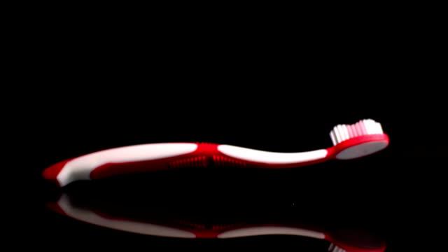 Pink toothbrush falling video