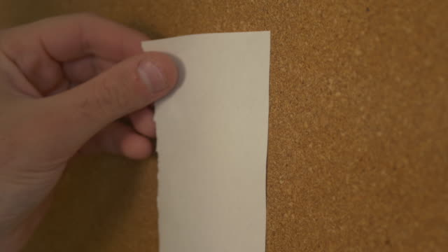 Pinning a paper on cork board video