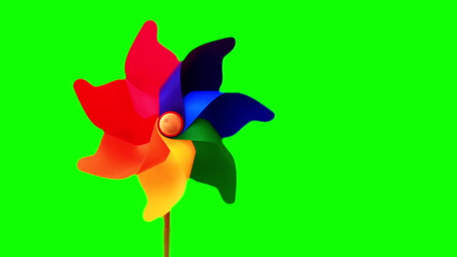 Pinwheel toy over green video