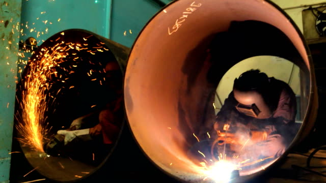 pipe factory welder and fitter at work - saldare video stock e b–roll