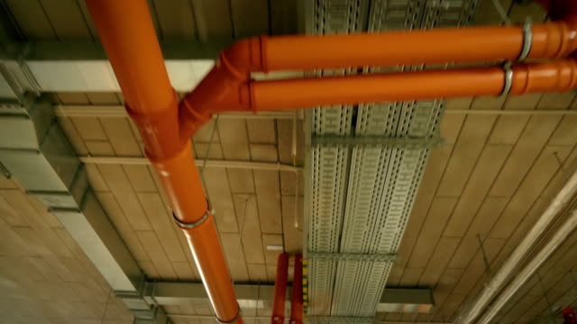 pipeline on the ceiling in factory in 4k slow motion 60fps - soffitto video stock e b–roll