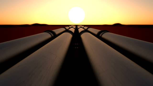 Pipeline transport oil, natural gas or water in metal pipe by sunset