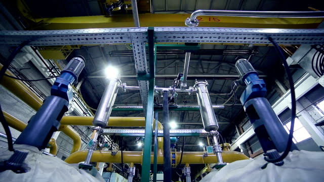 Pipes in a industrial factory. Chenical, gas, oil, water, bio gas tubes Huge rtubes. Biogas production from natural products. chlorine stock videos & royalty-free footage