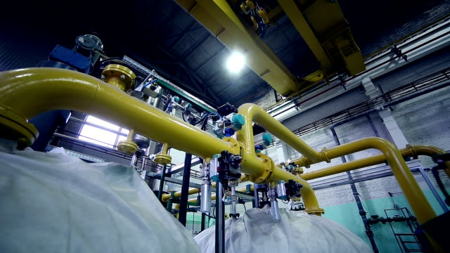 Pipes in a industrial factory. Chenical, gas, oil, waterbio gas pipes