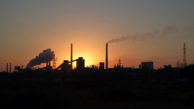 Pipes of an industrial enterprise at dawn