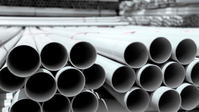 PVC pipes stacked in warehouse. video
