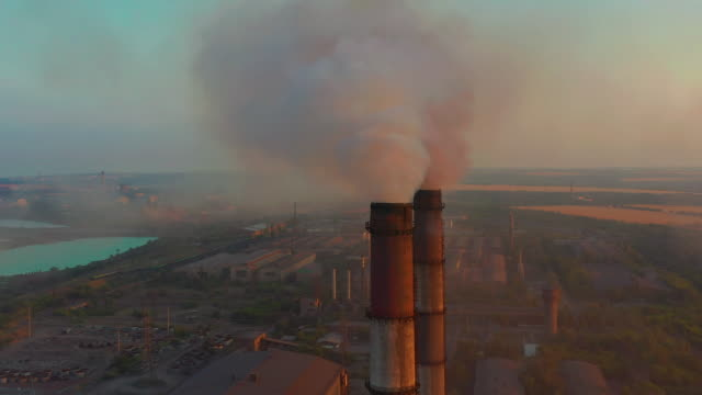 Pipes with smoke: industrial production. Thick smoke comes from industrial chemney. Concept air pollution