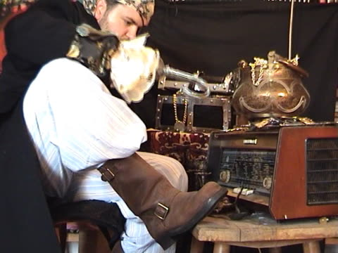 pirate radio Pirate, trying to change frequency on the old radio with his hook. artificial limb stock videos & royalty-free footage