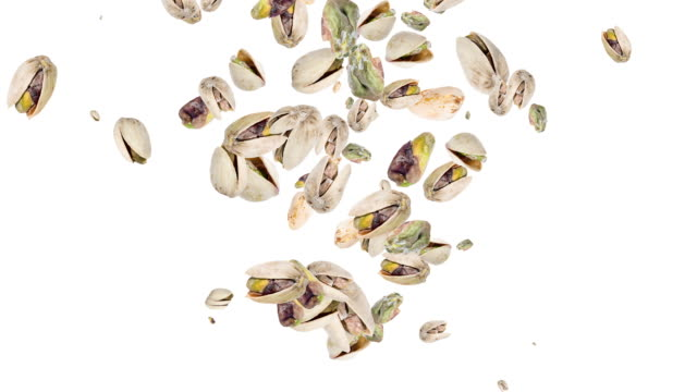Pistachios falling down and forming a heart video