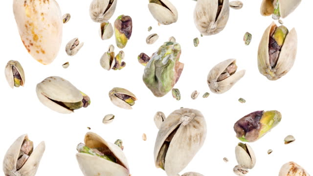 Pistachios falling down (ends on blue) video