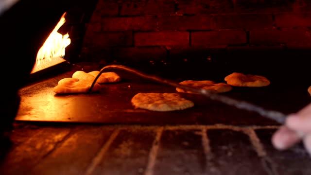 pita baking process in oven. pita bread in oven. - chleb pita filmów i materiałów b-roll