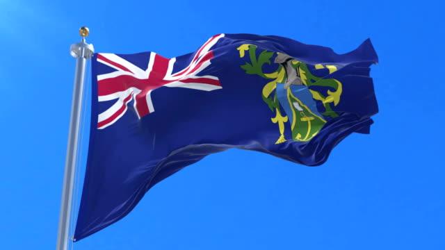 Pitcairn Islands flag waving at wind with blue sky in slow, loop video