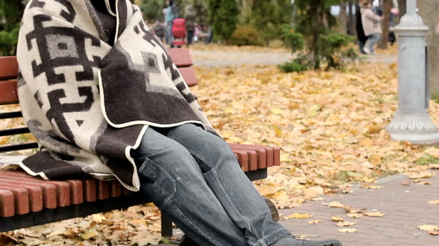 Pitiful jobless man sitting on bench in park, homelessness, social vulnerability video