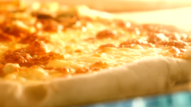 Pizza baked in the oven, melting, seething. Close up video