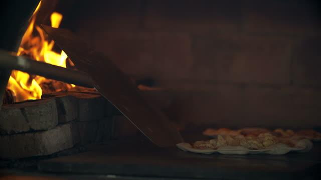 4K: Pizza baking in brick pizza oven video