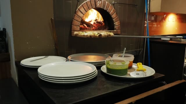 Pizza chef preparing pizza at the restaurant Pizza chef preparing pizza at the restaurant pesto sauce stock videos & royalty-free footage