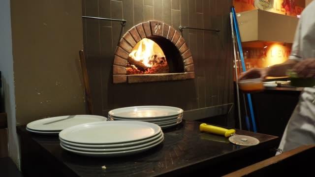 Pizza chef preparing pizza at the restaurant