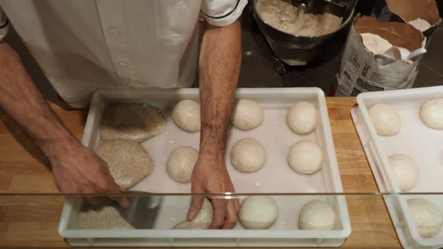 Pizza chef preparing the pizza dough at the restaurant