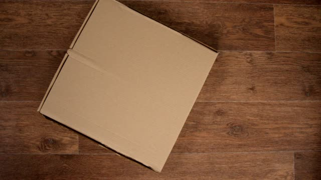 Pizza delivery in a box and parsing it in pieces with hands, stop motion animation