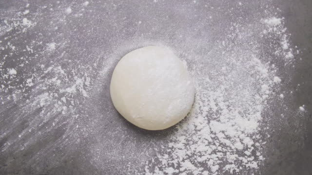 Pizza Dough Ball in the kitchen slate bench Pizza Dough Ball in the kitchen slate bench dough stock videos & royalty-free footage