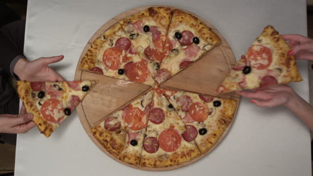 pizza from the top - pizza stock videos and b-roll footage