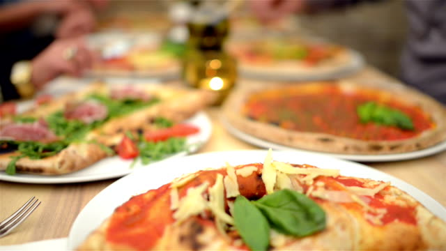 dolly: pizza meal in restaurant - italian food stock videos & royalty-free footage